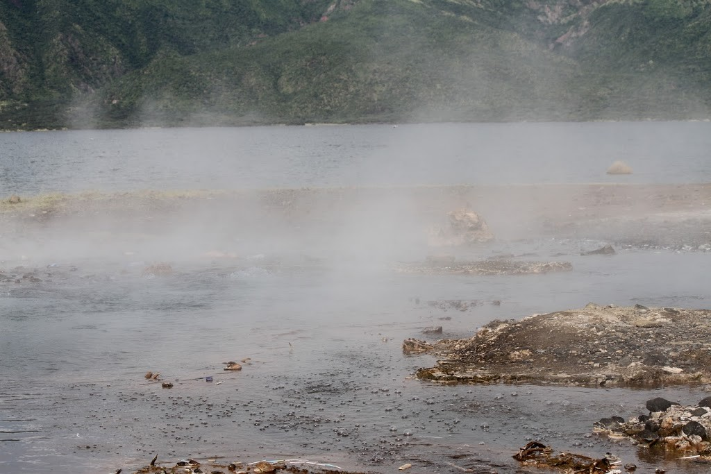 Bubbles and steam rise from Lake Bogoria
